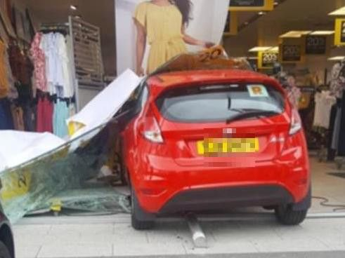 N.I. motorist crashes car with R plates through clothes shop window