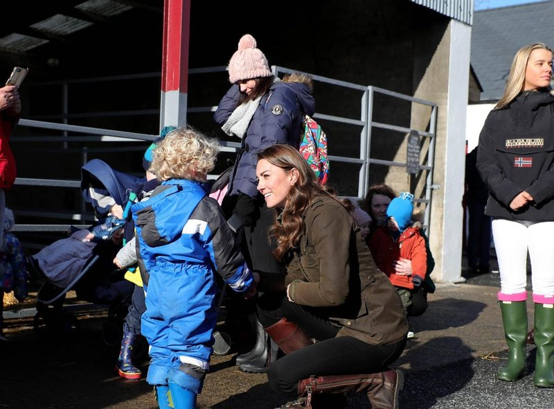 The Duchess of Cambridge meets members of the public at the Ark Open Farm, in Newtownards, near Belfast, during a visit to meet with parents and grandparents to discuss their experiences of raising young children for her Early Childhood survey