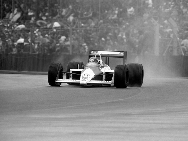 Ayrton Senna in his McLaren Honda on his way to victory in a rain lashed British Grand Prix at Silverstone