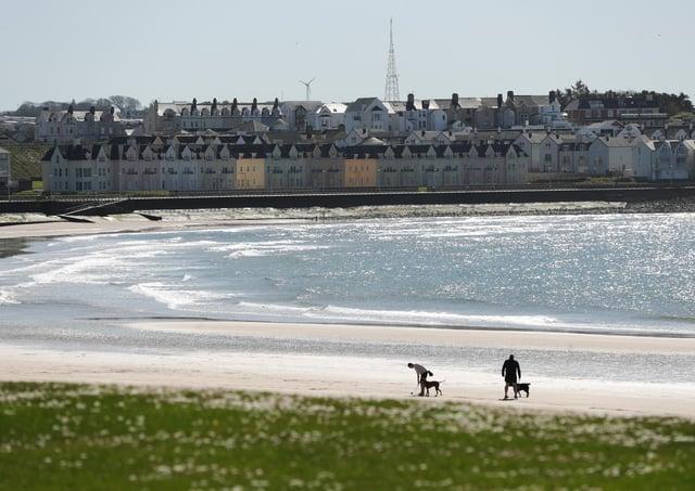 General view of a quiet West Strand beach in Portrush, Co Antrim -  Photo by Kelvin Boyes / Press Eye.