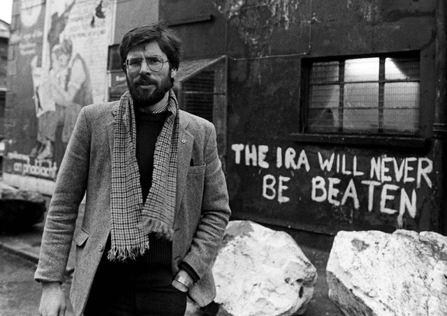 Sinn Fein president Gerry Adams pictured outside the party's HQ on the Falls Road in January 1984