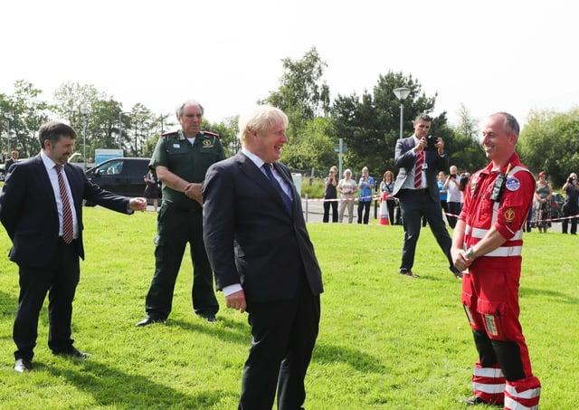 Mr Johnson at a photo op at a Belfast ambulance centre on Thursday
