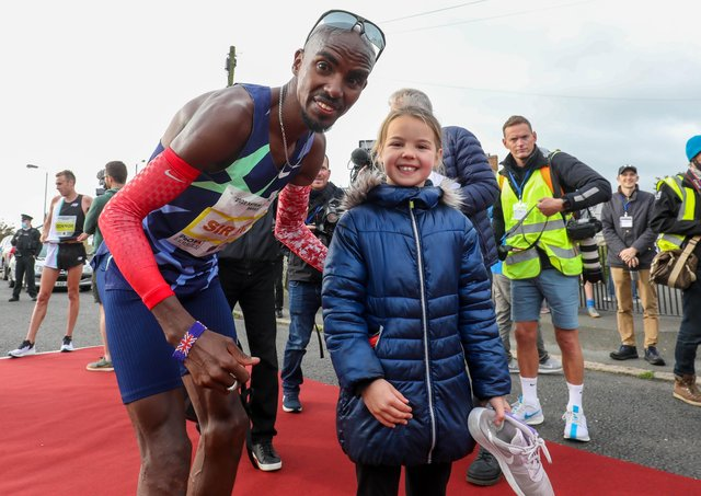 Sir Mo Farah's appearance at the Antrim Coast Half Marathon proved a big draw for eight-year-old Mia Duddy and other fans. Pic by PressEye Ltd.