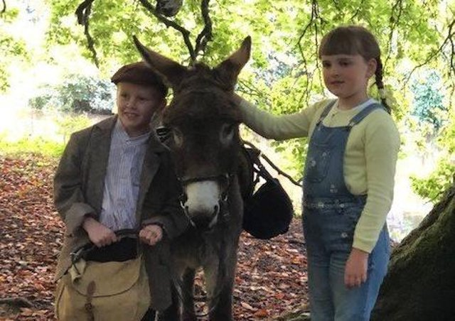 Young Actors Jude Hill and Savanna Burney Keatings with Denis the Donkey