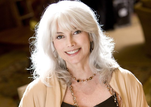 EmmyLou Harris, musician, holding Gibson Les Paul guitar with Coal River Mountain image on its face