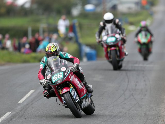 Adam McLean leads his McAdoo Racing team-mate Darryl Tweed in the Supertwin race at the Cookstown 100 last year.