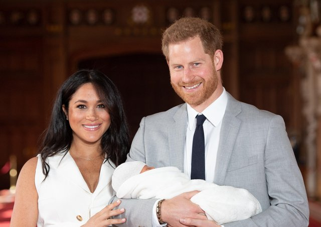 Harry and Meghan with Archie as a baby