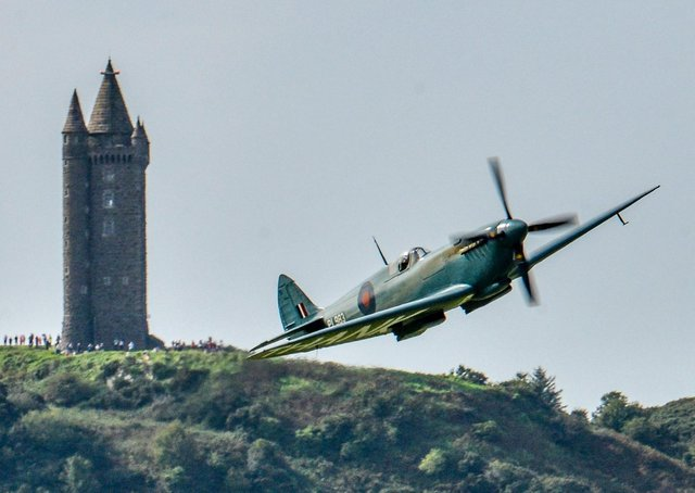 A Spitfire flies close to Scrabo Tower in Newtownards in September 2020. Picture: Simon Graham
