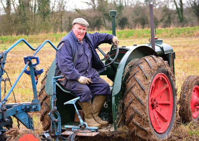 William Steenson from Markethill, Co Armagh, with his 1943 Fordson tractor at the 99th Mullahead Ploughing Match in February 2014. Picture: Gavan Caldwell/News Letter archives