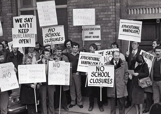 """More than 50 teachers had launched the campaign to save the schools threatened with the axe. Teachers from Dunlamber Boys' and Somerdale Boys' Secondary Schools protesting outside the Belfast Education and Library Board office in February 1982. In a statement issued to the News Letter the teachers stated: """"There is not a single educational reason to justify the decision to close either of these schools. It will effectively destroy an exercise of parental choice of schools in north Belfast. It will handicap an progress towards a properly planned rationalisation of resources in north Belfast for the next twenty years."""" The staff at Somerdale school had blocked the Crumlin Road for 30 minutes during their lunchtime before joining their Dunlambert colleagues in a delegation to the board headquarters in Academy Street. Picture: News Letter archives"""