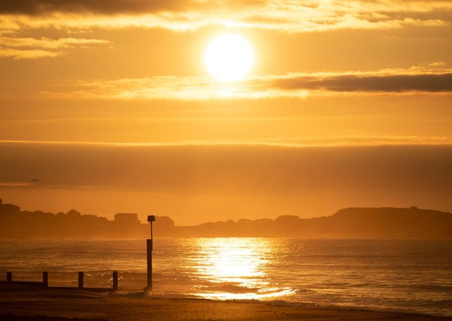 The sun rises over Boscombe beach in Dorset on the day of the Spring equinox this morning.  The worst of lockdown in short dark days is over. Photo: Andrew Matthews/PA Wire