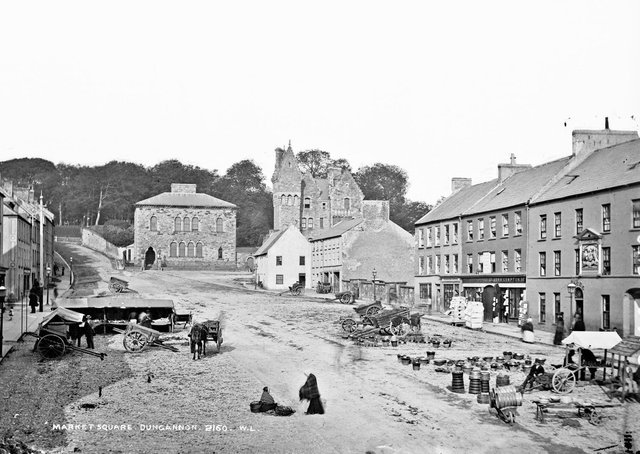 This is beautiful old photograph of the Market Square in Dungannon, Co Tyrone from the archives of the National Library of Ireland. It shows traders set up in anticipation of sales to the people who must surely come to the market. Catalogue range circa 1865-1914. Definitely after 1871 (tower). And before 1891 (post office) Likely circa1800 (businesses). NLI Ref: L_CAB_02160. Picture: National Library of Ireland