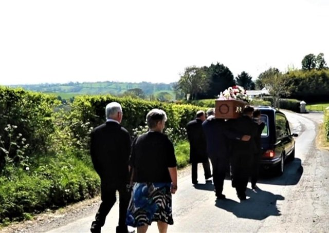 A small group following the hearse ahead of Charlie Poots' burial