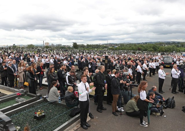 A crowd listens to former Sinn Fein president Gerry Adams speak during the funeral of Bobby Storey at Milltown cemetery in west Belfast on June 30, 2020. Photo: Liam McBurney/PA Wire