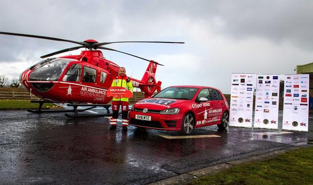 Glenn O'Rorke, Air Ambulance NI Operational Lead, launches the Osborne Car Competition alongside the helicopter at the Air Ambulance NI base. Over 400 tickets sold so far