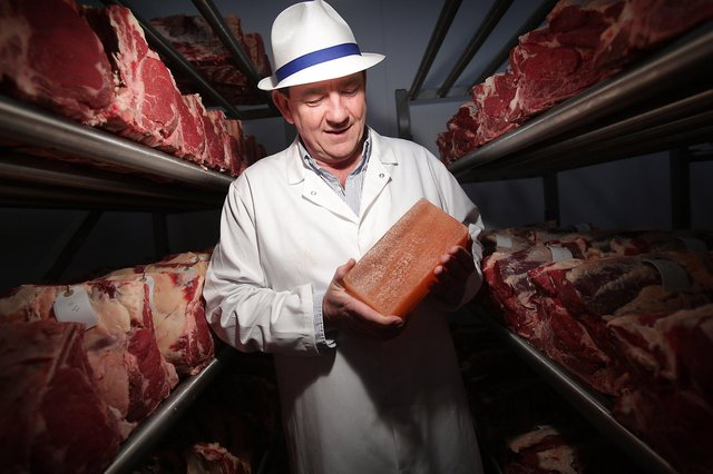 Peter Hannan of Hannan Meats and the Meat Merchant retail operation in Moira selecting meat in the vast Himalayan salt chamber for the company's premium meat boxes
