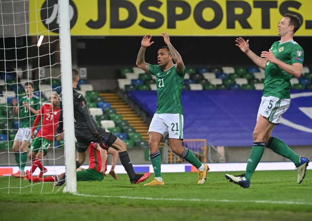 Northern Ireland's Josh Magennis and Jonny Evans react in frustration last night during the World Cup qualifiers' scoreless draw with Bulgaria. Pic by Pacemaker.