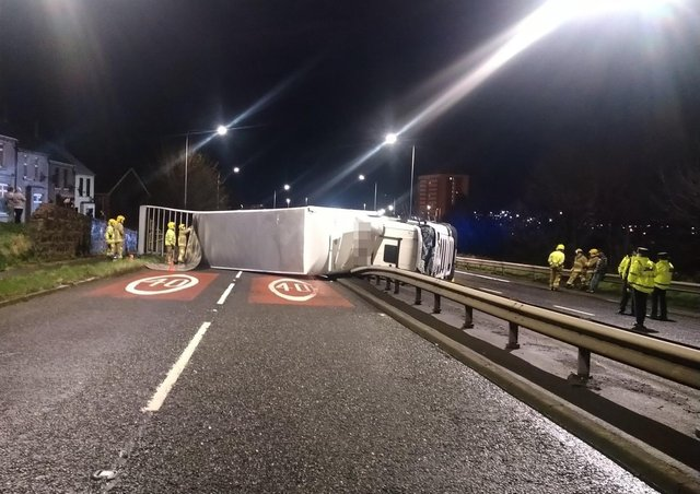 Emergency services at the scene on Sunday after a lorry overturned in Larne.