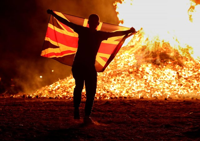 A reveller at the 12th of July bonfire