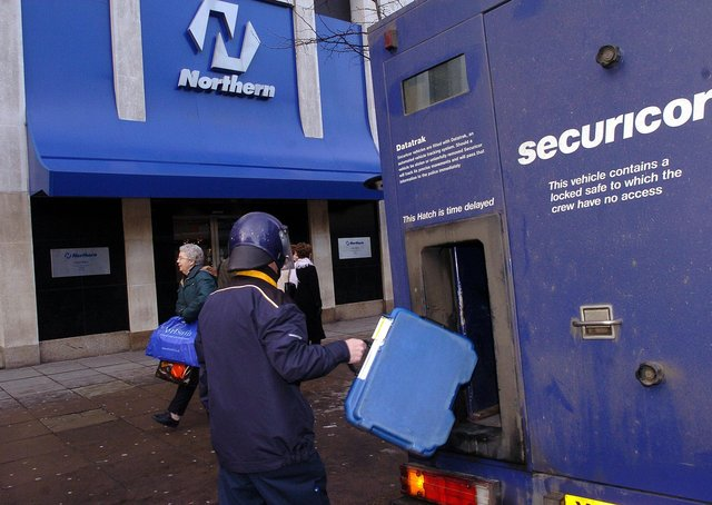 IRA murders and other major crimes, such as the largest bank robbery in British history (at the Northern Bank in Belfast, seen above the day after), were mere bumps in the road. Picture Pacemaker December 2004