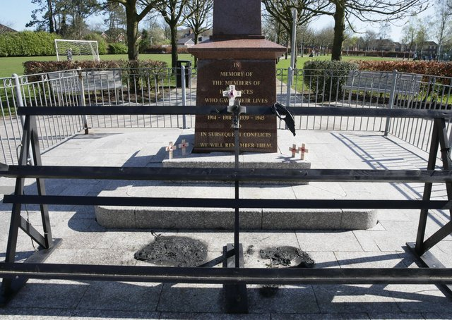 Poppy wreathes arranged on a special stand were burned and scorch damage caused at Glengormley war memorial. Police are treating the attack as a hate crime. Photo Stephen Davison/Pacemaker Press