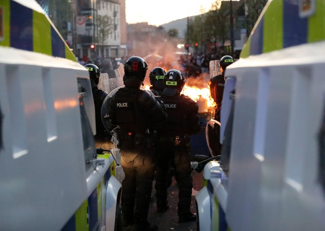 Loyalists take part in a protest at Shaftsbury Square near Sandy Row in south Belfast as the PSNI moved in to disperse the crowd.Photo by Kelvin Boyes / Press Eye.