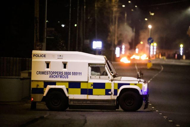 Cars burning at the Doagh Road roundabout of Newtownabbey in Co Antrim. Photo by Kelvin Boyes / Press Eye.
