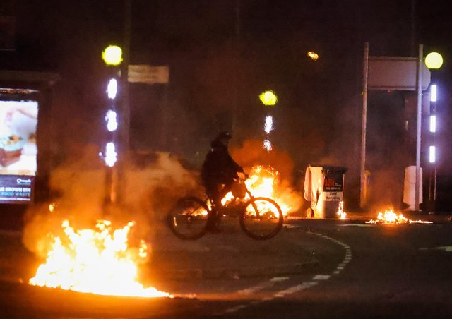 Cars burning at the Doagh Road roundabout of Newtownabbey in County Antrim on Saturday night. Photo by Kelvin Boyes / Press Eye.
