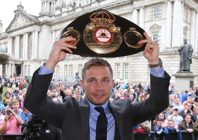 Carl Frampton lifts the belt in front of fans during his homecoming event at Belfast City Hall in 2016. Pic by PA