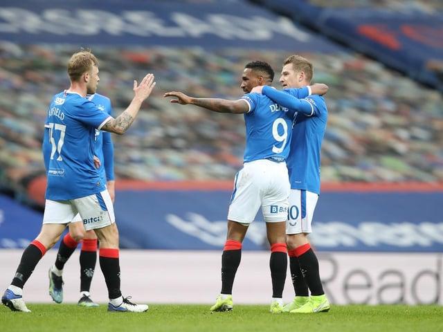 Rangers Jermain Defoe celebrates with teammates Scott Arfield and Steven Davis after scoring their team's first goal