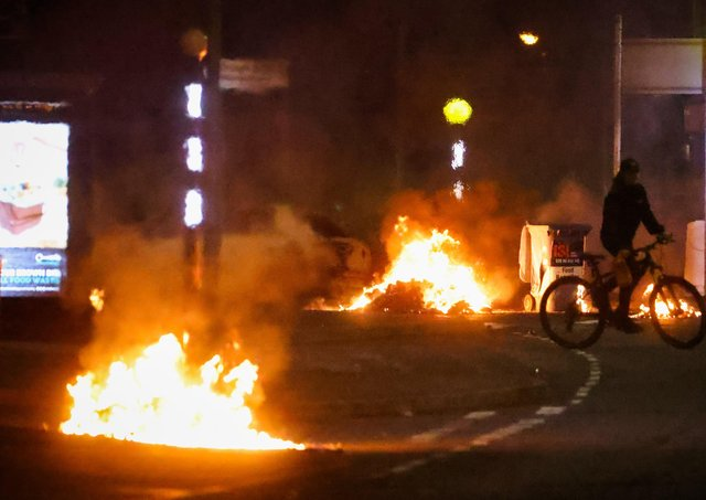 Cars burning at the Doagh Road roundabout of Newtownabbey in County Antrim on Saturday night. There was further trouble in Newtownabbey and Carrickferugs on Sunday night. Photo by Kelvin Boyes / Press Eye.