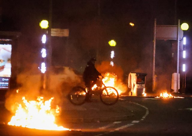 A general view of cars burning at the Doagh Road roundabout of Newtownabbey in County Antrim on Saturday. Photo by Kelvin Boyes / Press Eye.