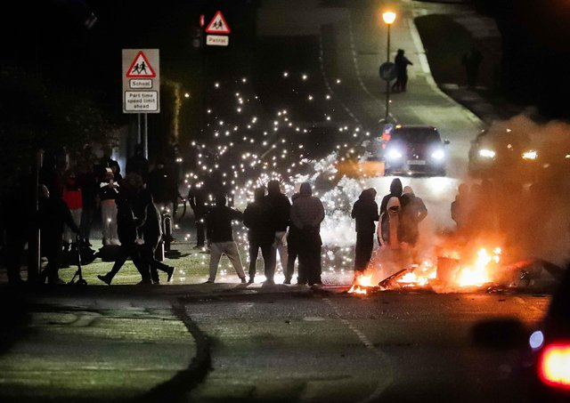 oyalists block the North Road in Carrickfergus close to the Castlemara Estate in Co Antrim on Monday evening.