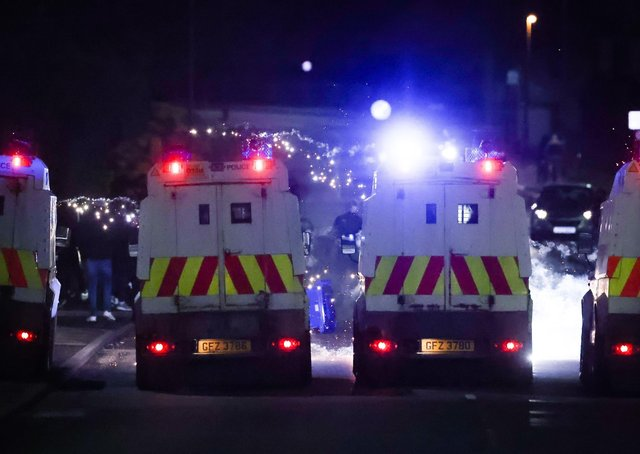 PSNI pictured on the Antiville Road on Tuesday after loyalists took part in a protest at the Antiville roundabout