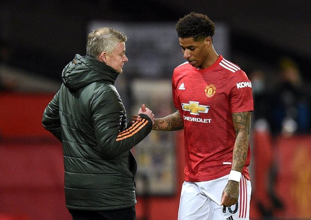 Manchester United's Marcus Rashford (right) with manager Ole Gunnar Solskjaer. Pic by PA.