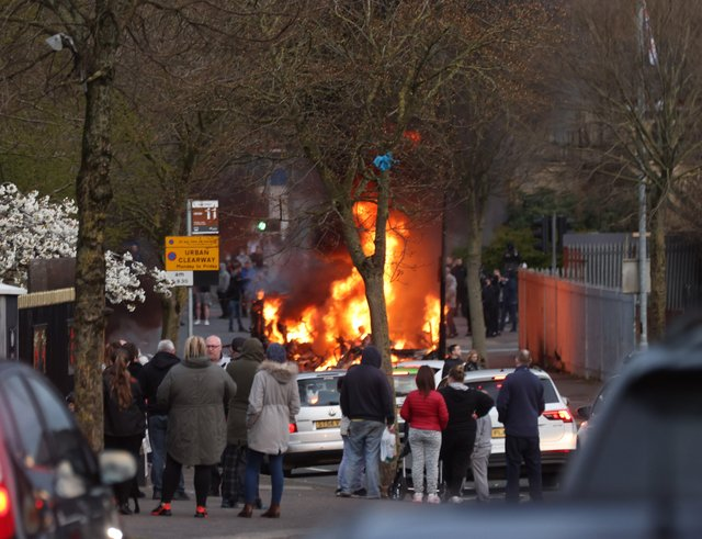 A bus is hijacked and set on fire during rioting on the Shankill road this evening.