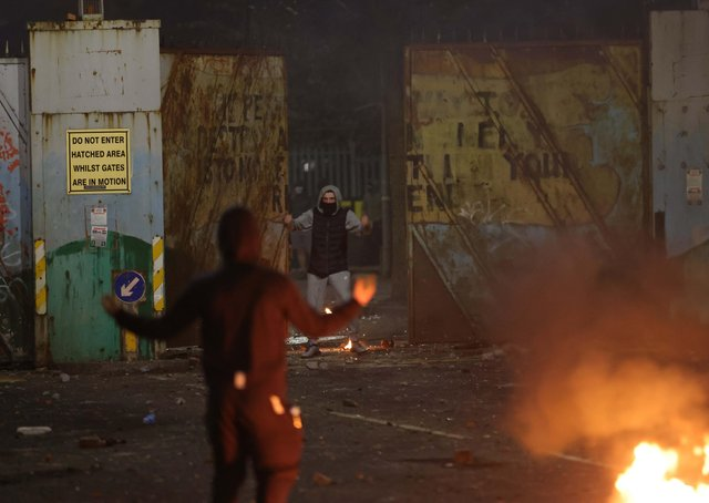 The peaceline gates at Lanark Way are forced open on Wednesday evening by rioting youths. Photo: Pacemaker Belfast