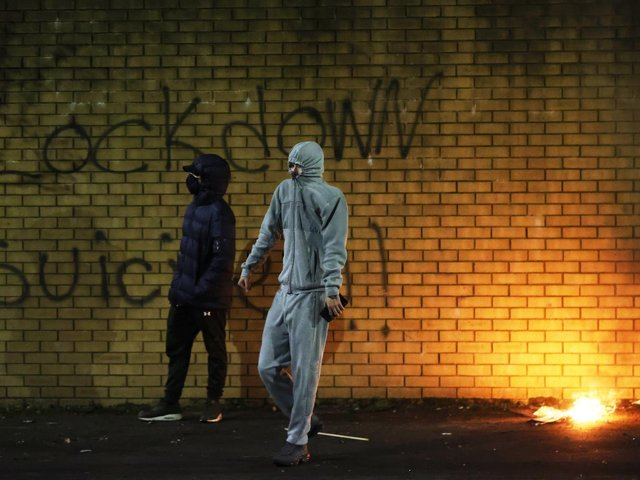 A man carrying bricks in Belfast during further unrest in Belfast. (Photo: PA)