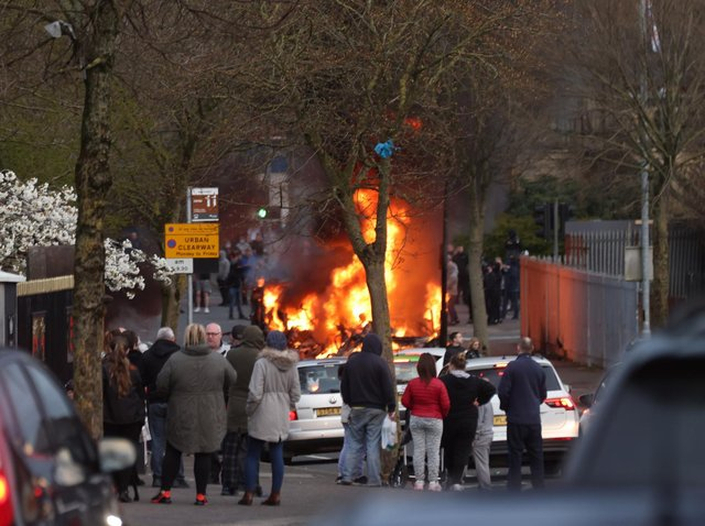 The bus driver and passengers were forced off the double-decker bus before it was torched by youths with petrol bombs.