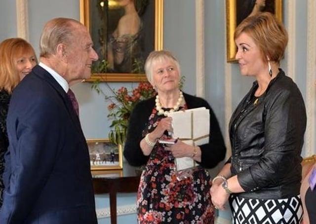 U105 presenter and sports journalist Denise Watson meeting Prince Philip at Hillsborough Castle in 2015. Photo: Aaron McCracken/Harrisons