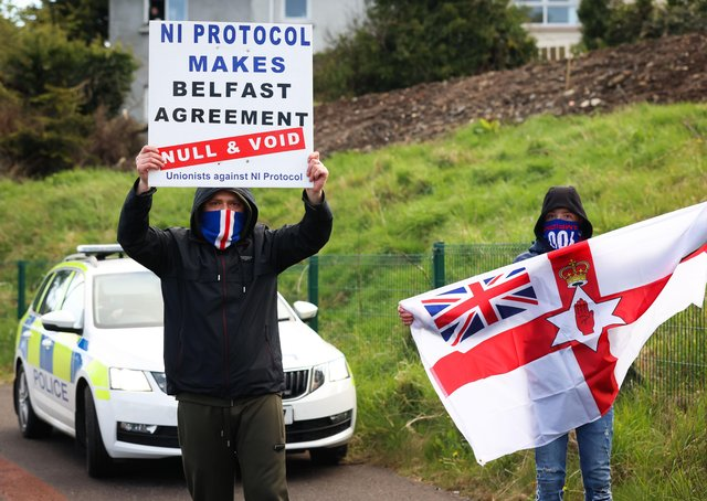 Press Eye - Belfast - Northern Ireland - 6th April 2021Loyalists take part in a protest at the Antiville roundabout in Larne County Antrim.Unionist communities loyal to the UK believe the Brexit sea border threatens Northern Irelandâ€TMs constitutional position within the union.Border Control Posts (BCPs) were built at Larne harbour, and two other facilities in Northern Ireland, as a consequence of Brexit.Photo by Kelvin Boyes / Press Eye.