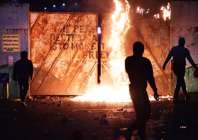 Rioters pictured at the Lanark Way interface on Wednesday night. The following evening was less violent – but still saw lawlessness. Photo: Pacemaker