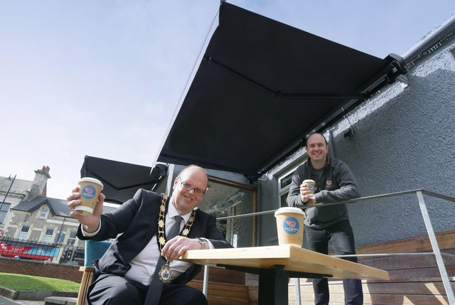 Mayor of Antrim and Newtownabbey, Councillor Jim Montgomery with Daniel Brown from Browns Coffee, Ballyclare, who recently benefitted from the installation of an awning to his business premises