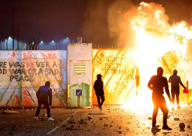 Loyalist and republican youths threw petrol bombs and other missiles across the Lanark Way interface in west Belfast at the height of the disorder. Photo: Stephen Davison/Pacemaker