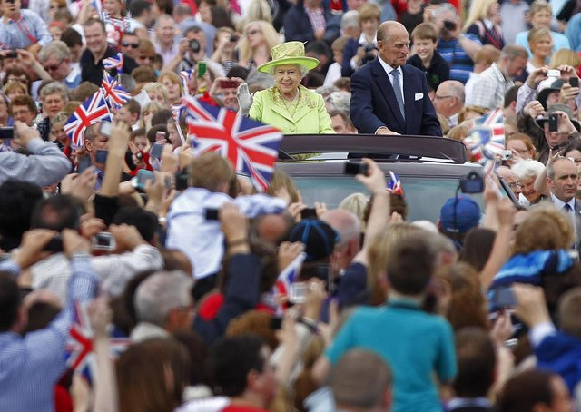 Queen Elizabeth and Prince Philip were a fixture in public consciousness from 1947. When they visited Stormont in the 2012 jubilee year, above, it was weeks after the Queen had seemed visibly concerned for the health of her consort, who was in hospital, but he bounced back and remained active through most of his 90s. Photo: Julien Behal/PA Wire
