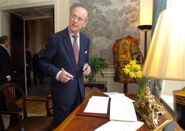 """Prince Philip signing the visitors' book at Hillsborough Castle after meeting recipients of the Duke of Edinburgh Award scheme in March 2007. Lord Dodds says: """"We take pride that Northern Ireland boasts the highest participation levels in his scheme"""""""