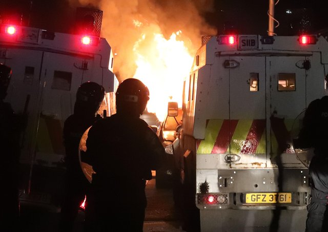 PSNI deal with a burning hijacked car in the Tiger's Bay area of North Belfast last night. Photo by Kelvin Boyes  / Press Eye.