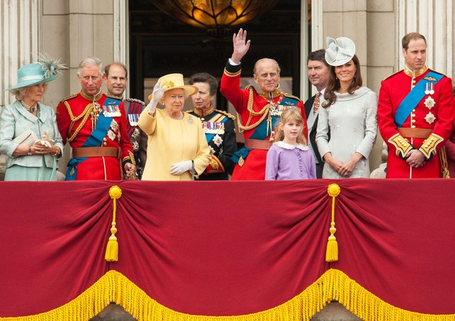 """The Queen and Prince Philip wave to crowds from Buckingham Palace in 2012. Archbishop Martin writes: """"Her Majesty the Queen, and all the members of the Royal family, are in our prayers on the death of a much loved husband, father, grandfather and great grandfather"""""""