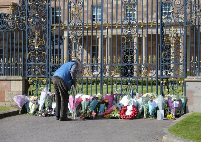 Members of the public have left florals tributes to the Duke of Edinburgh at Hillsborough Castle. Photo: Philip Magowan / Press Eye