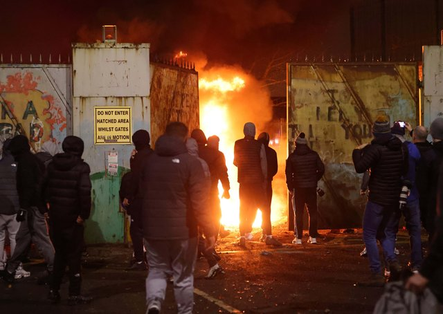 Rioters last week at the peace gates in Lanark Way in west Belfast, which were forced open. Picture Pacemaker